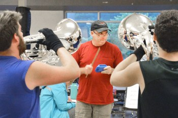 Photo by Robin Hart/robin.hart@amnews.com Boyle County Band Director Matt Emerson, keeps rhythm by striking a block as the horn section practices a piece from their competitive band show.