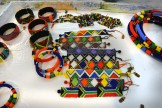 Collection of hand-woven, beaded bracelets, headbands and eye glasses neck holders.