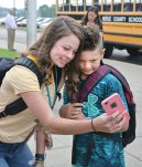 Maddie Ethington, who is entering eighth grade at Boyle County Middle School, takes a selfie with her brother Quentin, who was about to walk into third grade at Woodlawn.