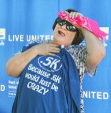 Cathy Camic of Harrodsburg makes a funny face while posing for a photo after finishing the race.