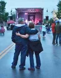 Jim and Judy Gramstad, of Danville, stand arm in arm while listening to the music by Magnolia Vale Saturday night.