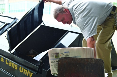Bobbie Curd/bobbie.curd@amnews.com Steve deposits the recycled newspapers into the container at the back of The Advocate building.
