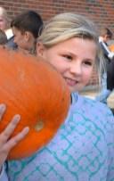 Robin Hart/robin.hart@amnews.com Taylor Kirkland seems pleased with the large pumpkin she found.