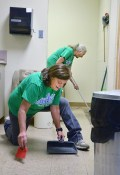 On Wednesday morning, Kathy Briscoe sweeps the floor as Susan Legault mops a small room at Bluebird Market during the Heart of Kentucky Day of Action. Bluebird Market sells donated furniture and accessories to raise money for the Wilderness Trace Child Development Center.