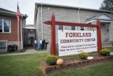 Photos by James Morris Friends gather in front of the Forkland Community Center during the festival.
