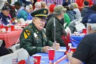 Photo by Robin Hart/robin.hart@amnews.com Bernard Alsip,of Perryville, talks with a fellow veteran during the annual Veterans Day lunch at the National Guard Armory on Monday. Alsip retired as Chief Warrant Officer 4 after a 30-year career with the U.S. Army.