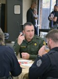 Photo by Robin Hart/robin.hart@amnews.com Taylor Bottom, with the Boyle County Sheriff's Office, listens to a radio call during Thursday's first responders' appreciation lunch sponsored by Hope Network and Boyle County ASAP.