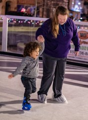 Ben Kleppinger/ben.kleppinger@amnews.com Paige Ratliff of Danville holds 2-year-old River Watkins' hand as he learns to skate.
