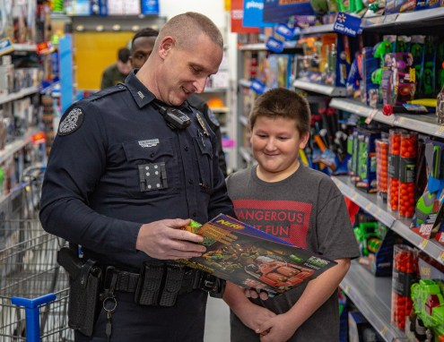 Ben Kleppinger/ben.kleppinger@amnews.com Danville Police Officer Aaron Sparks looks at a Nerf gun with Perryville Elementary School student David.
