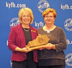Photos contributed Thelma Blair of the Lincoln County Farm Bureau Women's Committee, accepts the 2018 Gold Star Award of Excellence from Vicki Bryant, chair of the Kentucky Farm Bureau state Women's Committee. The award was presented during a November 30 recognition program at the 99th Kentucky Farm Bureau annual meeting.