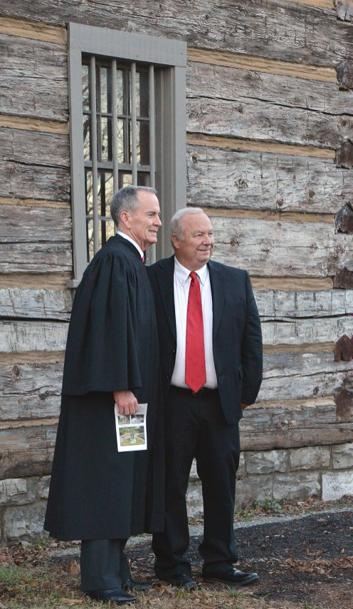 Kentucky Supreme Court Justice Laurance B. VanMeter and Boyle County Judge-Executive Howard Hunt pose for a photo Monday before the swearing in ceremony of 17 elected officials.