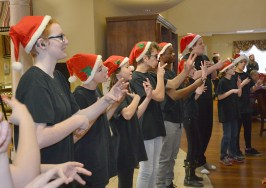 Photo by Robin Hart/robin.hart@amnews.com Members of the Kentucky School for the Deaf Signing Choir perform for residents at McDowell Place on Tuesday.