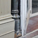 The bottom of an original, ornate iron post can be seen at the building located in downtown Danville at 311 West Main Street.
