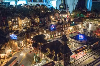 Ben Kleppinger/ben.kleppinger@amnews.com The cities inside John Bowling's home model train layout feature fully lighted buildings and streets that can come to life when the main lights are turned off.
