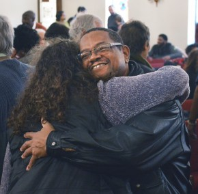 Photos by Robin Hart David Payne hugs Courtney Shewmaker during the annual MLK Day event at First Baptist Church early Monday afternoon.