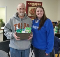 Pete Kovarbasick, left, with Katy Roy was winner of the door prize given during the Rook Tournament.