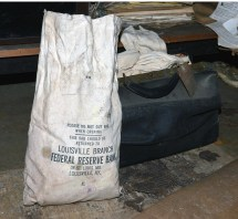 A black satchel is still full of old cloth money sacks that were once used to transport cash to a federal reserve bank in Louisville. Photo by Robin Hart