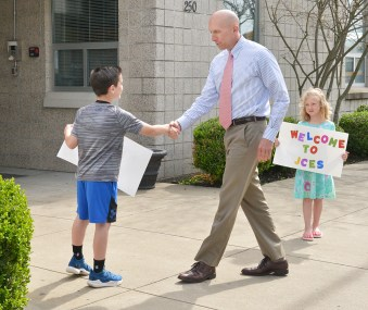 Boyle County Schools Superintendent Mike LaFavers shakes hands with Ryker Coffman as Ava Wright watches. They were greeting visitors to Junction City Elementary School's Leadership luncheon on Thursday.