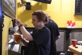 Jaime Iocono serves up one of her last beers during the last night of operation. Photo by John Scarpa