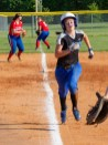 Samantha Bottom runs home to score for Danville as a Nelson County player (#13) fields a single to left field by Natalie Fieberg in the second inning. (Photo by Ben Kleppinger)