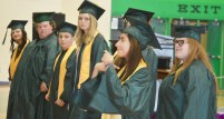 """Sulmi Vasquez signs a line to the senior class song, """"The Champion."""" (Photo by Robin Hart)"""