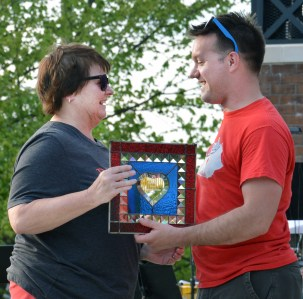 Denise Wade receives the Heart of Danville's Volunteer Award from HOD's interim executive director Dustin Duvall. Wade's husband, Jimmy also was named on the award. Photo by Robin Hart)
