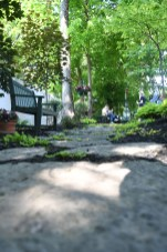 Stepping stones lead the way through a garden during the garden tour in Danville on Saturday. (Photos by John Scarpa.)
