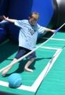 Colwyn Reardon, age 7, blocks a goal on a giant foosball set in the park in downtown Danville. (Photo byJohn Scarpa)