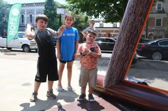 Keaton Riley, Gracie Hall, and Kollin Riley throw foam tomahawks. (Photo by John Scarpa.)