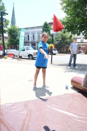 Gracie Hall, age 8, throws a foam tomahawk. (Photo by John Scarpa )