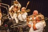 The trombone section of the Advocate Brass Band performs during the band's Saturday evening concert at the Norton Center. (Photo by Ben Kleppinger)