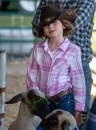 Addison Putnam, 8, from Garrard County, waits to show her sheep, Buckweed. (Photo by Ben Kleppinger)