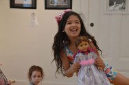 Keianna Aguilar dances witrh her doll, Felicity, during play time at the Community Arts Center's Dollie and Me camp. (Photo by Chloe Games)