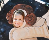 """Lucy Snow, 5, poses as Princess Leigh from the Star Wars movies during the Boyle County Public Library's summer reading kickoff event Monday. The theme for this year's program is """"A Universe of Stories."""" (Photo by Robin Hart)"""