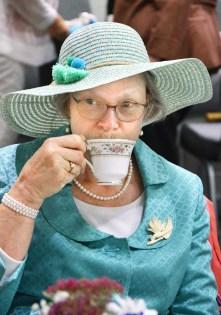 LeeAnn McCann sips tea during the annual Great American Brass Band Festival kickoff event, the Chautauqua Tea Thursday afternoon at Centenary Methodist Church. (Photo by Robin Hart)