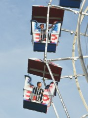 Riders on the farris wheel look over the fairgrounds before the sun set Tuesday evening. (Photo by Robin Hart)
