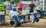 Kacee Bently rides her garden tractor named Phsycho during the pull event Tuesday night. (Photo by Robin Hart)