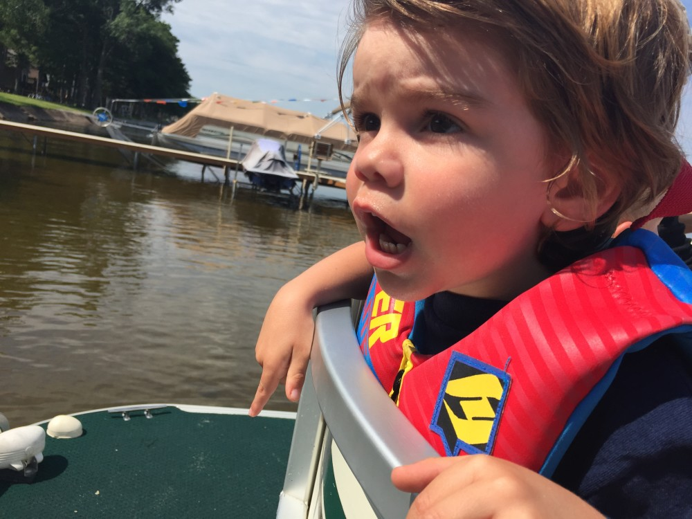 He was shouting at his daddy to get on the boat.