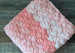 baby girl crochet blanket pattern - amorecraftylife.com -bernat blanket yarn baby blanket - baby afghan - free printable crochet pattern chunky blanket pattern #baby #crochet #crochetpattern #freecrochetpattern