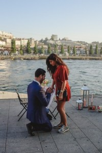 surprise wedding proposal at ribeira do porto with him on his knees