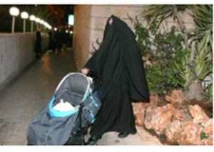 Jewish women with veil pushes stroller