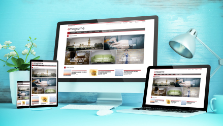 blue responsive desktop with devices showing responsive magazine website