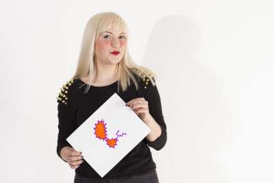 Meghan Farnsworth holds up her purple and orange spiky version of an Ampersand