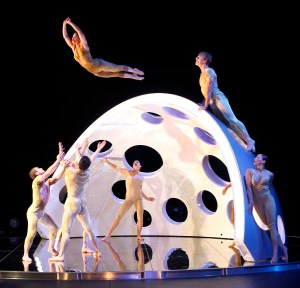 The dancers work through the unknown together as they prepare to catch one who bounds over the brain-like dome. Photo Courtesy of Thomas Ammerpohl.