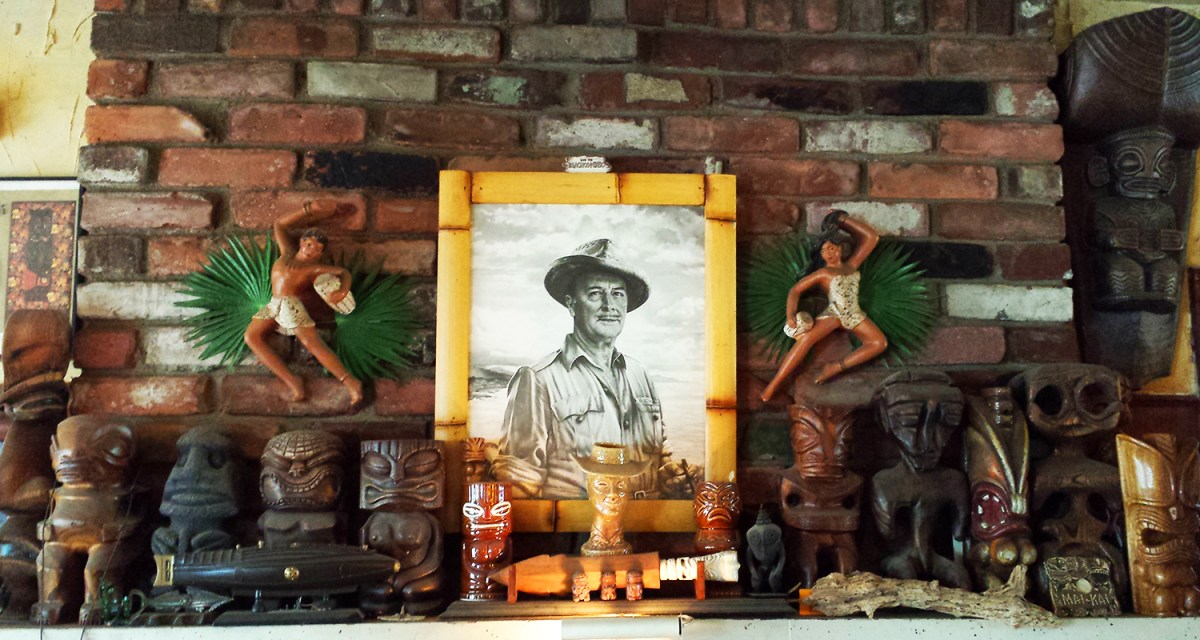 A photograph of Don the Beachcomber among various tiki-related items above a fireplace in Sven Kirsten's home.