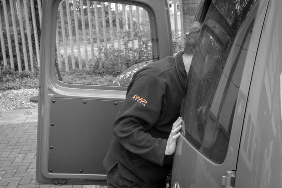 Call out and repair James leaning into the back of a van