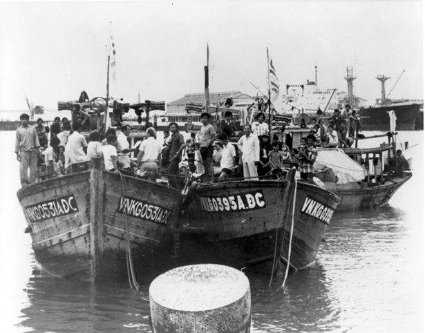 Vietnamese boat people arrive in Darwin Harbour in 1977.