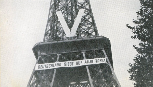 """""""Germany triumphs on all fronts."""" Eiffel Tower under German occupation, 1940."""