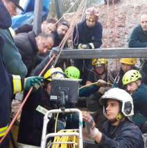 Mining rescue team reviews borehole footage