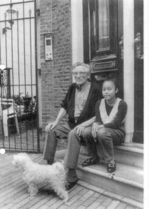 Former kingpin of Amsterdam's Red Light District, sitting in front of house which is now Hofje van Wijs.